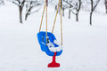 Empty swing in winter chair covered snow Stock Images