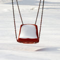 Empty swing in winter time with snow Stock Photography