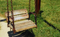 Empty swing wooden on the playground Royalty Free Stock Images
