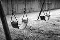 Empty swings in black and white remind me of my childhood memories Stock Photography