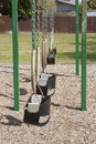 Empty swings in a childrens playground Stock Photo