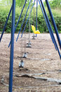 Empty swings in the park Royalty Free Stock Photo