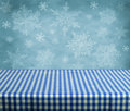 Empty table with blue gingham tablecloth over winter background great for product display montages Stock Photos