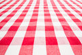 Empty table covered by red gingham tablecloth top view Stock Image