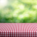 Empty table and defocused foliage green background great for product display montages Stock Images