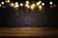 Empty table in front of black and gold glitter lights background Royalty Free Stock Photo