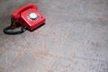 Empty table with red phone in background - telephone on desk Royalty Free Stock Photo