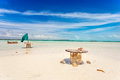 Empty tables on beach abandoned cable drum white sand near five cays providenciales turks and caicos Stock Photo
