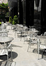 Empty tables and chairs of a sidewalk coffee shop in ho chi minh city vietnam Royalty Free Stock Images