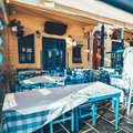 Empty tables in greek cafe on Crete Island, Greece Royalty Free Stock Photo