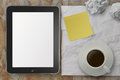 Empty tablet pc and cup of coffee with stickly note on crumple p paper as concept Royalty Free Stock Photos