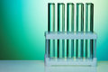 Empty test tubes organized and fixed in rows on the light green background Stock Photography