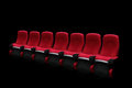 Empty theater auditorium or cinema with red seats one row Stock Image