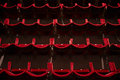 Empty theatre hall view of an with red seats in row Royalty Free Stock Image
