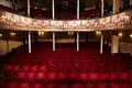 Empty theatre view of an with red seats and balcony Royalty Free Stock Photography