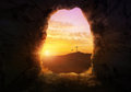 Empty tomb with three crosses on a hill side Stock Image
