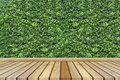Empty top wooden table and green leave texture on background. Can use for product display Royalty Free Stock Photo