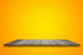 Empty top wooden table and yellow gradient background. for product display Royalty Free Stock Photo