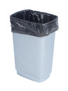 Empty trash container with black plastic bag on white background Royalty Free Stock Photo