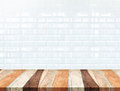 Empty tropical wood table and blur white ceramic tile brick wall Royalty Free Stock Photo