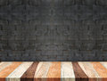 Empty tropical wood table and blurred black brick wall background. product display template.Business presentation Royalty Free Stock Photo
