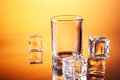 Empty tumbler with ice cubes Royalty Free Stock Images