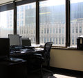 The empty and unemployed workstation with sun entering through office window Royalty Free Stock Photo