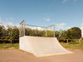 An Empty and Unused Ramp Half Pipe at the Skate Park in the Coun Royalty Free Stock Photo