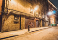 Empty urban alley at night Royalty Free Stock Photo