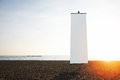 Empty vertical banner on the beach at sunset Royalty Free Stock Photo