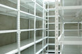 Empty warehouse racks empty metal shelf storage room storage concept Royalty Free Stock Image