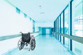 Empty wheelchair parked in hospital hallway Royalty Free Stock Photo