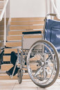 Empty wheelchair and stairs. Disabled accessibility reality. Royalty Free Stock Photo