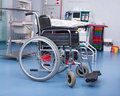 Empty wheelchair in surgery room Royalty Free Stock Photo