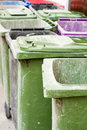 Empty wheelie bins a group of with lids open Stock Image