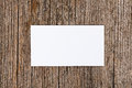 Empty white card over wooden background Royalty Free Stock Image