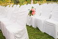 Empty white chairs in outdoor wedding Stock Photo