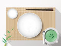 Empty white plate set with chopsticks on a bamboo cover. Vector Royalty Free Stock Photo