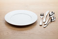 Empty white plate with silverware Royalty Free Stock Photo
