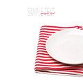 Empty white plate on tablecloth Royalty Free Stock Photo