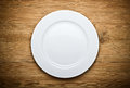 Empty White Plate on Wood Stock Images