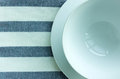 Empty white plates and bowl with tablecloth background Royalty Free Stock Photos