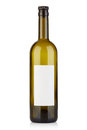 Empty wine bottle with cap and blank label on white Royalty Free Stock Photo