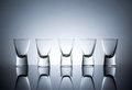 Empty wine glasses with reflection standing in a row Royalty Free Stock Photo