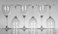Empty wine glasses six on grey background Stock Photo