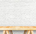 Empty wood modern table and grunge white brick wall in backgroun Royalty Free Stock Photo