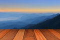 Empty wood table top with mountain background at sunrise Royalty Free Stock Photo