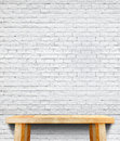 Empty wood table and white brick wall in background,Mock up temp Royalty Free Stock Photo