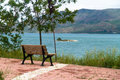 Empty wooden bench with viewpoint looking out to lake and mountain cloudy weather Stock Photography