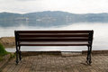 Empty wooden bench with viewpoint looking out to sea cloudy weather Royalty Free Stock Images